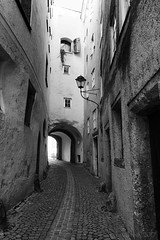 He must come through this hollow way ... (lunaryuna) Tags: austria salzburg oldtown alleyway gasse steingasse architecture historicarchitecture walkinthecity urbanconstructs blackwhite bw monochrome lunaryuna