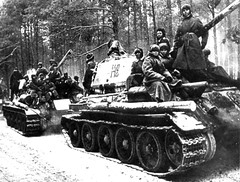 Column of Soviet tanks T-34-85 1-th guards tank corps with troops on the road in East Prussia.January, 1945