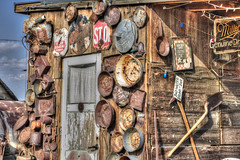 Bad Water (magnetic_red) Tags: building wood wooden western bar signs rusted rusty forgotten abadoned american west ghosttown goldpoint tools sky blue door christmaslights