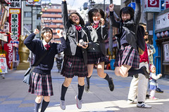 Shinsekai jumpers! (Eric Flexyourhead) Tags: shinsekai 新世界 naniwaku 浪速区 osaka osakashi 大阪市 kansai 関西地方 japan 日本 city urban street streetphotography japanese people schoolkids schoolgirls cute kawaii かわいい students uniforms jump jumping energetic fun friendly smile smiling happy shallowdepthoffield sonyalphaa7 zeisssonnartfe55mmf18za zeiss 55mmf18