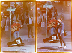 Cell Phone Girl (R. Drozda) Tags: seattle washington pikeplace busker guitar woman cellphone street johnnycash film expiredfilm minoltasrtcamera 35mmfilm drozda