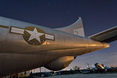 stars and bars. tucson, az. 2015. (eyetwist) Tags: eyetwistkevinballuff eyetwist night arizona tucson boneyard tail stars boeing kc97 stratofreighter tanker boomer refuel airplane aircraft graveyard nikkor nikon d7000 1024mm 1024mmf3545g arid fullmoon longexposure moonlight npy nocturne dark workshop desert sonorandesert rusty rust decay hulk abandoned wrecked dented metal dusty derelict junkyard old scrap storage amarg amarc davismonthan afb kc97g usaf airforce cargo freighter engines fuel coldwar airtoair refueling gasstationinthesky boomoperator belly american west starsandbars insignia star patina skin empennage urbex