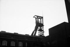 Zeche Zollverein (somekeepsakes) Tags: 2013 kentmere100 ruhrgebiet yashicaelectro35gsn analog analogue bw blackandwhite deutschland europa europe film förderturm germany industriekultur monochrom monochrome sw schwarzweis zechezollverein