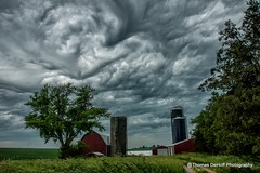 Storm clouds over the Iowa (Thomas DeHoff) Tags: red storm clouds barn sony iowa a700