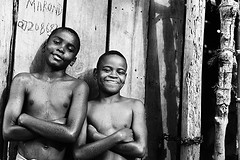 KEN-Lamu-1408-375-bw2 (anthonyasael) Tags: africa boy shirtless portrait people black smile look smiling horizontal kids laughing naked children fun happy kid friend child looking friendship kenya barechested african candid muslim joy happiness portraiture barefoot half afrika leisure amused lamu enjoying cheering halfnaked eastafrica toothysmile boysonly lookingatcamera topb anthonyasael