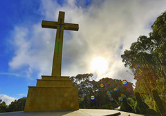 Memorial Cross : Bad weather . . . (Clement Tang ** busy **) Tags: travel cold landscape cloudy surreal windy australia victoria rainy backlit gusty hdr nationalgeographic mountmacedon macedonranges winterafternoon memorialcross patchofbluesky concordians scenicsnotjustlandscapes williamcameron brunogrollo rainbowcolouredsunglare rinogrollo 21metretallstatue