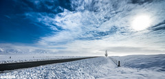 Be Still (lifedistilled) Tags: road blue winter newzealand sky panorama sun snow clouds zeiss fence frozen highway frost empty pano sony line nz flare hoar twizel panograph a99