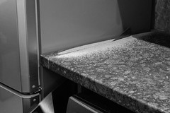 268/366 - Solution (Spannarama) Tags: 366 september blackandwhite saw worktop sawdust kitchen diy fridge fridgefreezer cut sawing home