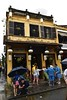 _DSC0620 (lnewman333) Tags: hoian centralvietnam vietnam sea southeastasia asia oldquarter tourists umbrella architecture rain