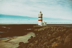 Grindavik Lighthouse (joshuadavidreid) Tags: lighthouse gridavik iceland stripes rocks
