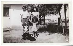 Vintage 1948 Snapshot : Jackie, Nellie, Skip, Jerry & Carol (CHAIN12) Tags: family woman man girl kids vintage mom photo backyard pretty dad sister father snapshot mother son doorway scanned brunette cybrsll1948skipcarol