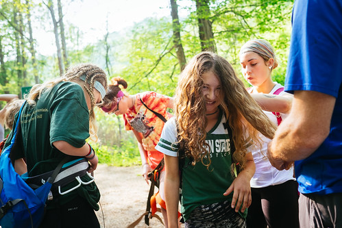 Braiding hair for a day of climbing