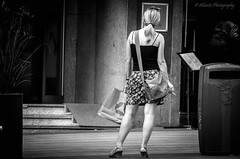 Recycle (Natalia Berrn) Tags: street urban bw woman monochrome hotel mujer waiting legs skirt bn smoking blonde rubia recycle bolsa guapa cigarro papelera piernas fumando falda coleta piti tirantes