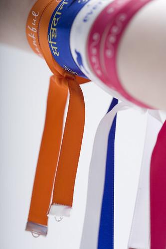15mm-oranje-lint-met-wit-bedrukt