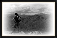 Thoughtful. (stu.bloggs..Dont do Sundays) Tags: summer blackandwhite bw mountains june clouds landscape scenery rocks path lakedistrict walker valley cumbria fells views hiker paths climber rucksack mrs vignette lakeland skiddaw borrowdale liningcrag rockyoutcrops greenupedge