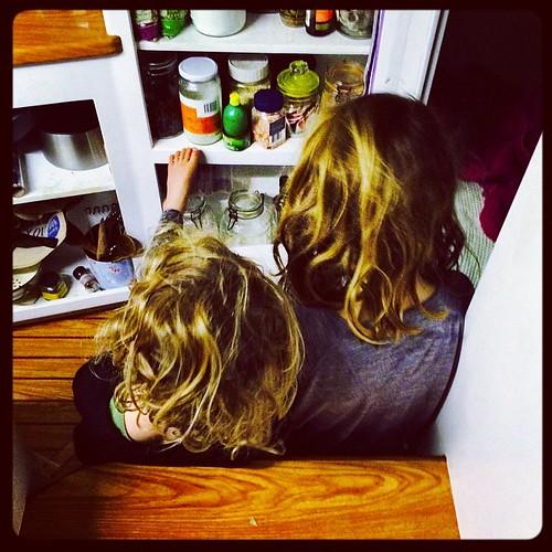 184/365 • reading the custard recipe last night • #184_2015 #4yo #7yo #cooking #plotting #liveaboard #custard #dessert #sisters #latergram #onedaywewillhavecupboarddoors