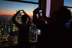 [ photographers ] ([ changó ]) Tags: newyork statiuniti topoftherock wwwriccardoromanocom usa us window skyscraper grattacielo night notte heart cuore mobile phone telefono telefoni people person persona gente persone street shot streetshot fotografi