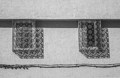 lacy windows (jen.ivana) Tags: window rail wall lace house architecture day home wire shadow light bw monochrome black white morroco marrakech