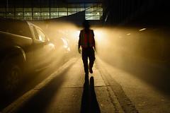 Canada. 2014. Calgary. Man in orange vest walking against the light by pratyay -