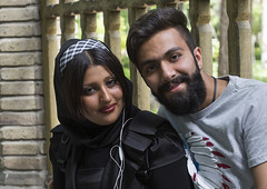 Smiling Iranian Couple, Isfahan Province, Isfahan, Iran (Eric Lafforgue) Tags: portrait people woman colour men fashion horizontal beard outdoors photography couple asia veiled veil dress adult iran muslim islam religion hipster middleeast hijab persia covered illegal males law iranian orient ban youngadult cultures esfahan rule 2people twopeople adultsonly islamic outlaw isfahan sharia theran chador ispahan traveldestinations colorimage lookingatcamera  tchador  tschador colourimage  iro isfahanprovince gelledhair  sepahan spadana westernasia religiouspolice fashionnable  hispahan haircutcode iran150980