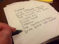 Writing down tonight's set list on the back of a napkin.