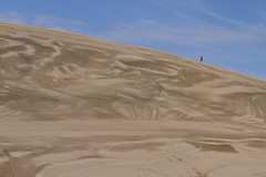 The Man on the Edge of Jupiter (brucetopher) Tags: sand dunes walk man hike travel toursim adventure pattern nature texture sky earth big giant run runner hiking