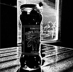 olive melange - hss (johngpt) Tags: appleiphone5 lowylensblackeysextrafinefilmnoflash olives window atwork table screenshot bottle hipstamatic sliderssunday hss