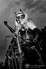 (Paul Cory) Tags: lighting camera city summer portrait sky people blackandwhite woman clouds buildings season lens costume afternoon unitedstates charlotte availablelight northcarolina naturallight weapon whip cosplayer dccomics softbox catwoman onlocation sciencefictionconvention strobe supervillain geolocation postprocessing fujicamera charlotteconventioncenter timeofday modifiers gridspot downtowncharlotte mecklenburgcounty heroescon radiotrigger niksoftware exif:make=fujifilm camera:make=fujifilm fujilens canon430exii lumiquestsoftboxiii canonstrobe exif:aperture=80 silverefexpro2 honl18inchgridspot colorefexpro4 yn622c fujifilmxf23mmf14r exif:lens=xf23mmf14r fujifilmxt1 exif:isospeed=200 exif:focallength=23mm camera:model=xt1 exif:model=xt1 heroescon2015 jessicapetro