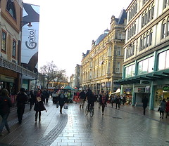 Part of Queen Street (southglosguytwo) Tags: 2016 buildings cameraphonephoto cardiff december queenstreet shops signs sky variouspeople