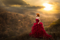 Sunset ({jessica drossin}) Tags: jessicadrossin woman sky sunset clouds hills landscape red dress redhead redhair sun golden wwwjessicadrossincom