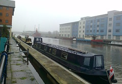 By part of the docks (southglosguytwo) Tags: 2016 barges boats buildings cameraphonephoto city cloudy december docks flag gloucester sky water bridge
