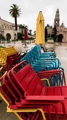 Primary Colours on El Prado (treehuggerdcg) Tags: utata:project=vibrant utata:description=hide utata weekendproject red blue yellow chair umbrella sandiego colours