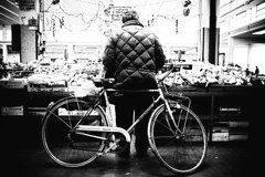 Triangular composition (Reportergimmi) Tags: old bw italy man vegetables bike shop fruit shopping blackwhite europe market bn biancoenero triangular bicicletta triangolo interestingness427 triangularcomposition