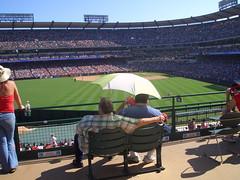 Two Baseball Fans (marc_omorain) Tags: sun green umbrella baseball redsox angels fans hash:sha1=e24ffc1a5675d60c4dceaae9655a329cf5596ba6