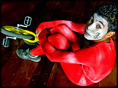 Balancing through adolescence on my monocycle - II (carf) Tags: poverty brazil boys brasil kids youth children hope kid community education child hummingbird circus performance performingarts culture esperana social impoverished underprivileged attitude masks acrobatics radical educational marcos beijaflor cultural adolescence monocycle photophilosophy thought1 ecbf