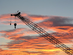 Sunset Crane (janinewhite) Tags: 2005 deleteme5 light sunset deleteme8 arizona deleteme deleteme2 deleteme3 deleteme4 deleteme6 deleteme9 deleteme7 topf25 beautiful silhouette work wow catchycolors interestingness saveme4 saveme angle mechanical crane saveme2 saveme3 deleteme10 albaluminis topc50 az intel chandler jgoldpac topv4444 osa themeatwork