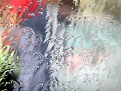 Rain Pane (comma?) Tags: blue red green window colors car rain interestingness blurred explore refraction nophotoshop throughthewindow