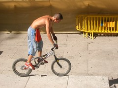 trickin! (elmada) Tags: madrid street blue red shirtless 15fav sexy bike bicycle yellow topv111 510fav fence catchycolors topv1333 jump spain topv555 topv333 bmx freestyle nipple topv1111 topv999 favme riding gloves sin topv777 shorts nipplering trial monty redshirt hotguy cuteguy bmxbike bikejump elmada blueshorts streetriding yellowfence bmxtrial