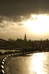 (ElseKramer) Tags: light sunset 15fav sun reflection monochrome amsterdam skyline clouds wow gold cityscape shadows elsekramer