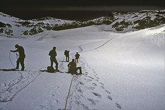 roping up - glacier du Sonadon (Ron Layters) Tags: mountains nature geotagged switzerland interestingness slide explore transparency wallis rescanned valais ronlayters slidefilmthenscanned glacierdusonadon fickrfly geo:lat=459237 geo:lon=731768 untanglingtherope preparingfortheday brightmoonlight highestpositioninexplore407onsaturdayoctober252008