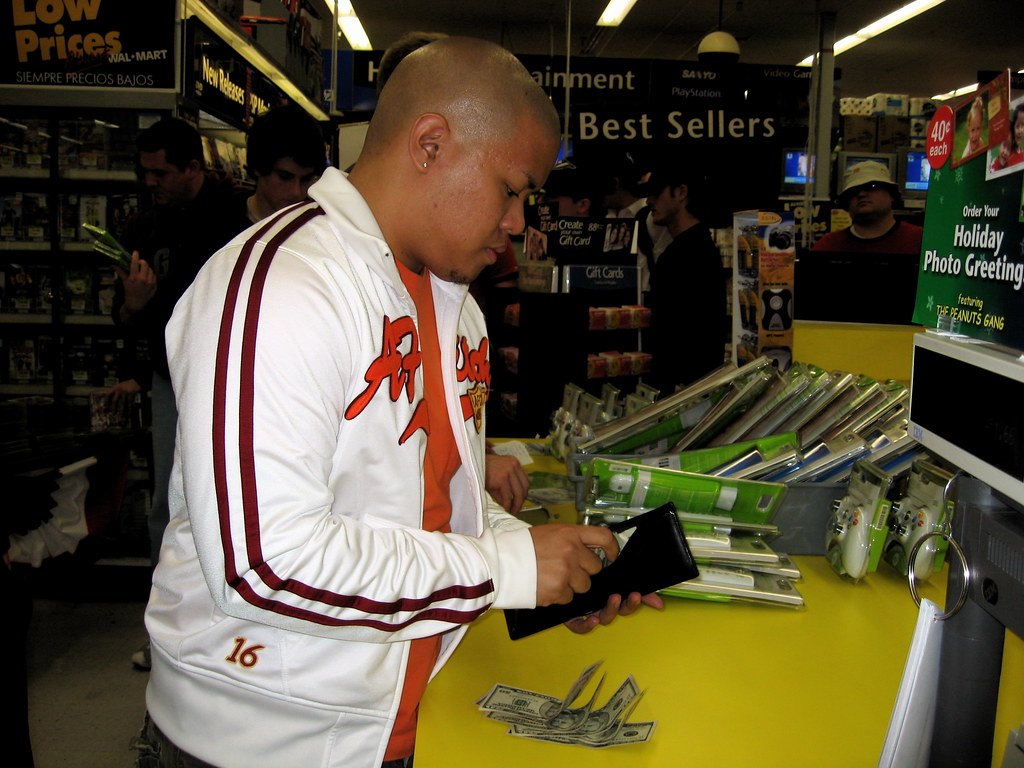 Paying cash money for the Xbox 360.
