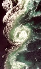 Water in a Twist: Saltstraumen, Norway (Reciprocity) Tags: 2005 vortex film water topv111 norway 35mm ilovenature spiral flow interestingness interesting bravo superia lovely1 tide arctic whirlpool current arcticcircle swirling maelstrom nikkormat saltstraumen printscan elementwater spiralling 555v5f 1500v60f