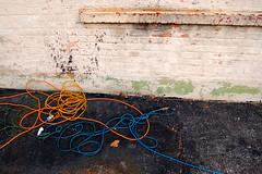 ledge (paul goyette) Tags: blue orange brick green yellow paint wrapped nikond50 cables ledge asphalt twisted tar 1835mmf3545d