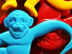 monkey monkey monkey yellow red blue (Brenda Anderson) Tags: blue red hot color macro yellow toy toys monkey tangle hold curiouskiwi 4diopter ccmpnotnature brendaanderson inagroup curiouskiwi:posted=2006