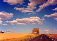 Mansfield, Washington (bentilden) Tags: road blue sky usa beautiful field topv111 clouds wow gold topv333 rocks peopleschoice easternwashington bjl2