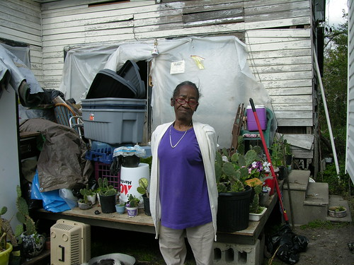 an elder who didn't get assistance after hurricane katrina, without a trailer living in an open house
