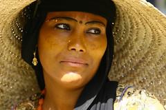 Women with a giant hat in Yemen (Eric Lafforgue) Tags: voyage travel portrait people republic felix middleeast arabic arab arabia yemen arabian sanaa ramadan tumeric yemeni yaman middleast arabie moyenorient jemen lafforgue arabiafelix  arabieheureuse  arabianpeninsula    ericlafforgue iemen lafforguemaccom mytripsmypics ericlafforgue imen imen yemni    jemenas    wwwericlafforguecom  alyaman ericlafforguecomericlafforgue contactlafforguemaccom yemenpicture yemenpictures