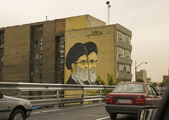 Billboard Of Khameini And Khomeini On A Building, Shemiranat County, Tehran, Iran (Eric Lafforgue) Tags: street portrait people signs history sign horizontal painting advertising poster beard dead outdoors photography death mural memorial asia paint peace iran propaganda painted muslim islam persia icon billboard national memory hero posters billboards leader iranian tehran orient heroic islamic teheran imam ayatollah urbanscene glorification commemorate khomeini glorify   colourimage  iro  nonwesternscript  shemiranatcounty iran150905