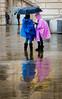 Dressed Like Flickr (DobingDesign) Tags: sanfrancisco california unitedstates us reflection street blue pink flickrbrandcolours umbrella wet rain rainyday water moisture wetsurface shelter waterproofs mac rainshield two women