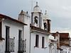 photo - Monsaraz Roofs, Chimneys, Bells (Jassy-50) Tags: photo monsaraz portugal hilltopvillage medievalvillage hilltop medieval village belltower tower chimney roof steeple balcony window